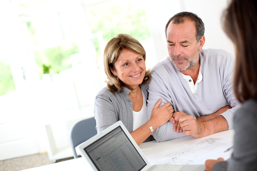 Photo of Senior couple ready to buy new house reading contract